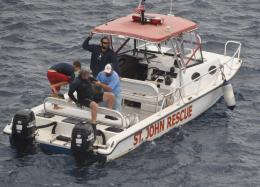 Eric Lambert gets rescued-260x187
